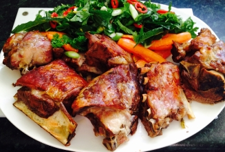 Slow cooked melt in your mouth shoulder of lamb with parsley and mint salad.